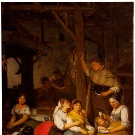 Interior de una casa de un pueblo de Aragón, cuando la familia se reúne por la tarde a tomar el chocolate